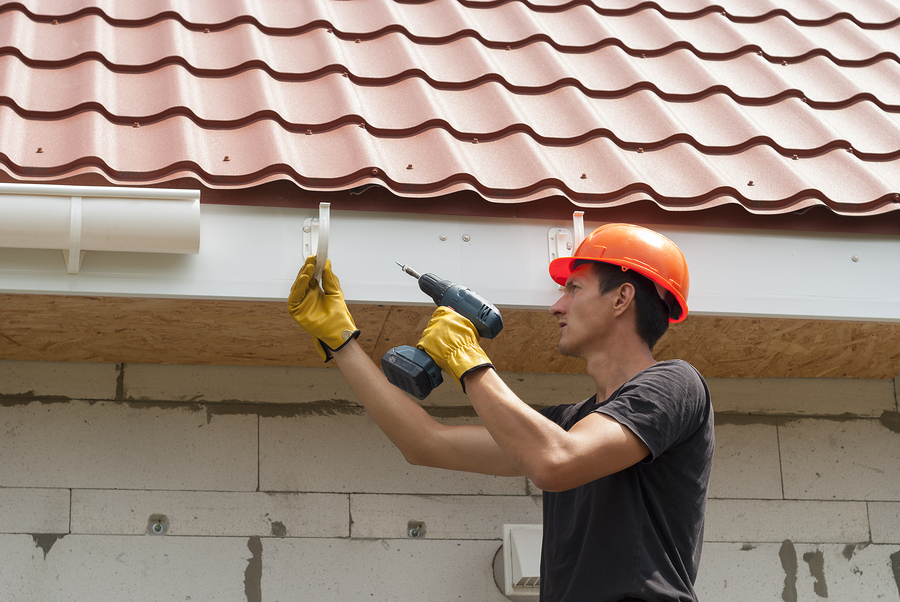 professional roofing experts doing gutter installation