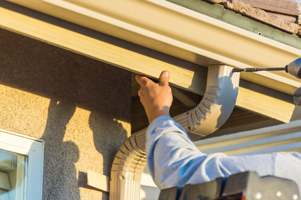 professional roofers doing gutter installation