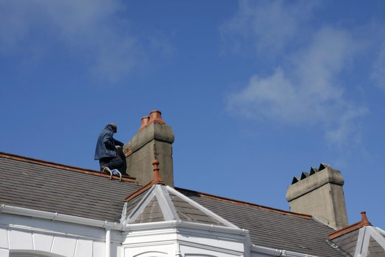 this picture shows a worker doing asphalt roofing at encinitas roofing pros