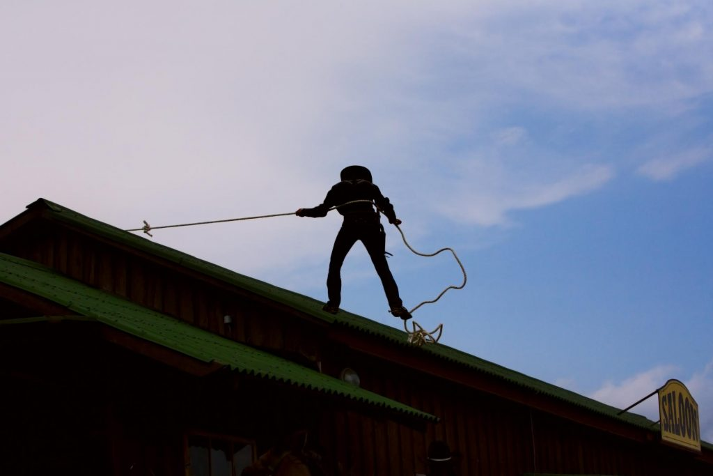 this is an image of a roofer performing maintenance of a flat roof